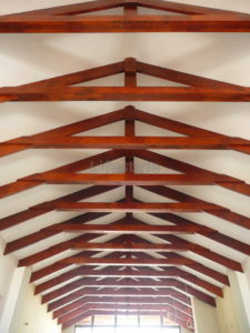 Red exposed roof trusses